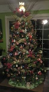 My Christmas Tree With Criss Cross Gold Ribbon Accented Red Bows Balls Are Lime Green And Brown
