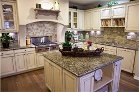 White Cabinets Dark Gray Countertops by Kitchen With White Cabinets And Dark Wood Floor Genuine Home Design