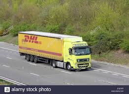 A DHL Truck Traveling Along The M20 Motorway In Kent, England Stock ... Dhl Truck Editorial Stock Image Image Of Back Nobody 50192604 Scania Becoming Main Supplier To In Europe Group Diecast Alloy Metal Car Big Container Truck 150 Scale Express Service Fast 75399969 Truck Skin For Daf Xf105 130 Euro Simulator 2 Mods Delivery Dusk Photo Bigstock 164 Model Yellow Iveco Cargo Parked Yellow Delivery Shipping Side Angle Frankfurt