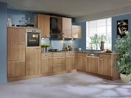 wood kitchen cabinets with light blue walls kitchen