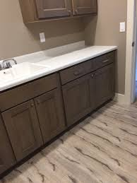 Armstrong Ceiling Tile Distributors Cleveland Ohio by Laundry Room In Coretec Vinyl Wood Flooring Style Augustine Oak