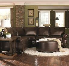 Brown Couch Living Room Decorating Ideas by Chocolate Brown Leather Sectional W Round Ottoman Picmia