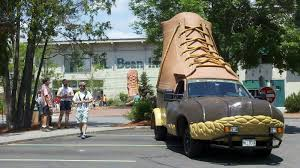 2 STORY LL BEAN HUNTING BOOT SHAPED TRUCK IN FRONT PARKING LOT OF