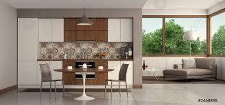 foto auf lager wohnzimmer mit moderner küche und runder tisch