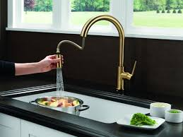 Delta Trinsic Faucet With Soap Dispenser by Faucet Com 9159 Ar Dst Sd In Arctic Stainless By Delta