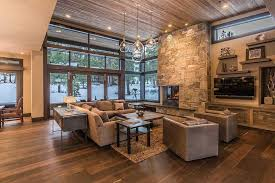 Modern Rustic Stone And Wood Living Room With Fireplace Beautiful Views Of The Outdoors
