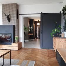 schwarz holzschiebetür im wohnzimmer reno türen