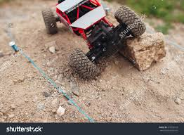 Top View On Rc Car Overcoming Stock Photo 519953143 - Shutterstock Diy Heavy Class Rc Vehicle Electronics 9 Steps Rc Remote Controlled Cars Track India Control Racing Car The Traxxas Jato 33 Bonafide Street Racer But Bozo On The Monster Trucks Hit Dirt Truck Stop Wl L959 112 24g 2wd Radio Control Cross Country Racing Car Adventures 6wd Cyclones 6 Tracks 4 Motors Hd Overkill Body Bodies Pinterest Caterpillar Track Dumper At The Cstruction Site Scaleart Outdoor Truck Madness Youtube Backyard Track 3 With Pictures