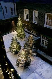 fake snow trees with lights outdoor christmas decoration ideas