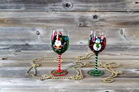 Horizontal Image Of Holiday Drinking Glasses Filled With Drink On Rustic Wood Stock Photo