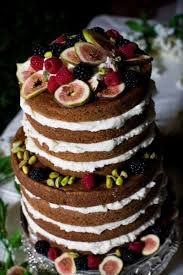Naked Rustic Wedding Cake Topped With Fruit For A Fall