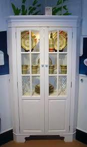 corner curio cabinet with light pulaski concave corner curio