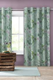 fabulous teal patterned curtains and cute green bear patterned