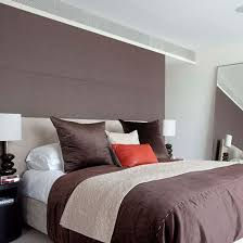 Hotel Style Bedroom With Rich Brown Feature Wall And Bedlinen