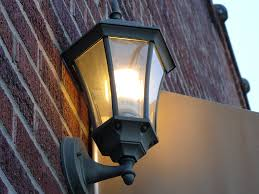 file a cfl light bulb on a wall in a black lantern in south