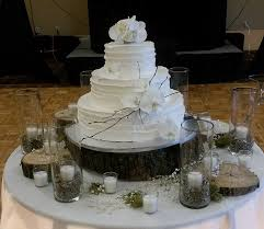Shown Above Is A Five Tiered Wedding Cake With Pearls And Hand Piped Decoration