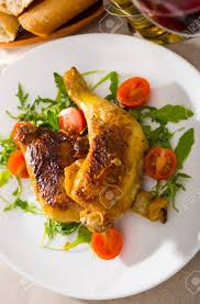 100 Golden Crust Roasted Chicken Legs With Golden Crust Served With Cherry Tomatoes