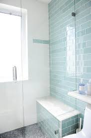 blue glass subway shower tiles with gray mosaic shower floor
