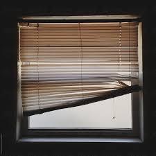 Crooked Blinds On Window Stocksy United