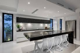 kitchen black marmer countertop ceiling lights accent white