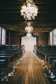 Love The Chandeliers And Variation Of Chairs Brick Wood Wedding Venue