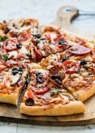 Homemade Pizza Using Dough On A Cutting Board