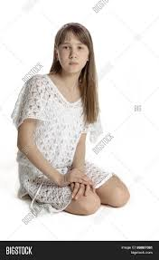 beautiful teen girl in white transparent dress isolated stock