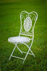 Metal White Garden Chair On Grass In Wedding Ceremony Stock Photo