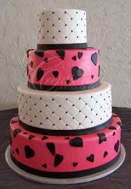 hot pink and white wedding cake with quilting and black hearts and base band