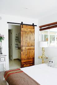 Before & After: Barn Door Installation - Decorating - Lonny Ideas Door Headboard Ipirations Old Find Out Reclaimed Barn In Here The Home Design 25 Bedrooms That Showcase The Beauty Of Sliding Doors Best Door Headboards Ideas On Pinterest Board Bedroom Barnwood Beds For Sale Used Queen Headboards Farmhouse Bed Mor Fniture For Less Tour This Playful And Functional Barnstyle Kids Room Hgtvs Diy Hdware New Make Modern Style Before After Installation Decorating Lonny Wallbed Wallbeds N More Rustic Woodworks Buy A Custom Made Shabby Chic Made To Order From