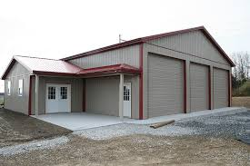 Steel garage building with two high overhead doors and a lean to