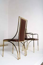 Stunning set of 8 dining chairs by Renato Zevi in brown calf leather