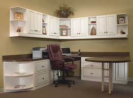 Home office with extended round table and lots of storage and wall