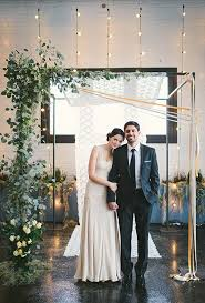 How Fun Is This Asymmetrical Backdrop When Accessorized With Crawling Greenery And Ribbon Streamers