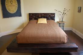 bedroom black stained hardwood low bed frame which decorated with