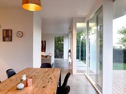 View In Gallery Wooden Dining Table And Black Chairs Create A Room Within The Kitchen With Ease