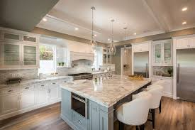 White Kitchen With Calacatta Carrara Marble Counter And Moody Blue Color Island Bar Stool Seating