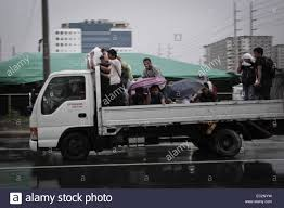 Pasay City, Philippines - Men Ride A Truck On Their Way Home As ... Watch Typhoon Jebi Knock Over Trailer Truck And Van Like Theyre Syclones And Typhoons To Descend On Carlisle Nationa The Gmc Syclone More Sports Car Than Tarco Timmerman Equipment Jay Talks Up His Lenos Garage Autotalk 1993 Street Youtube Gm Efi Magazine Gmc Trucks Chevy Trucks Truck That Made Me Into Gear Head Steam Workshop Kamaz