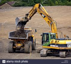 A Digger Filling A Dumper Truck With Soil Stock Photo, Royalty ... Digger And Dumper Truck Stock Photo Image Of Bulldozer 1436866 Dump Stock Photo 1522349 Shutterstock Tony The Cstruction Vehicles App For Kids Diggers Amazoncom Hot Wheels Monster Jam Rev Tredz Grave Unit Bid 51 2006 Sterling Truck With Derrick Boom Used Bauer Tbg 12 Man 41480 Digger Trucks Year Little Tikes Dirt 2in1 Toys Games And Working With Gravel Large Others Set In Tampa Tbocom Intertional 4400 Hiranger Bucket Small Bristol Museums Shop Bruder