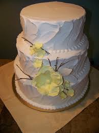 Twigs And Rustic Yellow Sugar Flowers On Rough Sided Buttercream Wedding CakesSugar