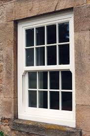 above vertical sliding sash window with shaped joggles this