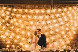 17 de light ful ways to use lights as wedding decor brit co