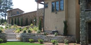 Tuscan Backyard Stone Walls Patio Accent Landscapes Colorado Springs CO