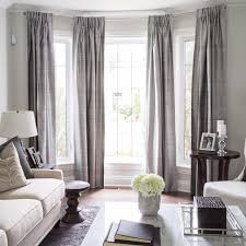 living room grey semi sheer curtains colorful pillows wooden