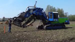 inter drain 1824t chain trencher laying field drainage combi