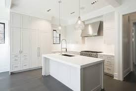 white kitchen island with two seeded glass pendants transitional