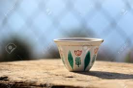 A Traditional Lebanese Coffee Cup On Wooden Table Stock Photo