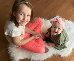 trendy affordable kids clothing for spring momma in flip flops