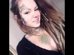 Pretty Girl Shows Her Face And Neck Tattoos