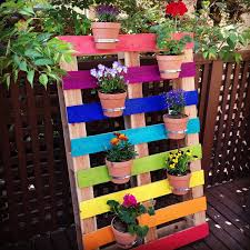 Create A Bright And Colorful Upcycled Rainbow Pallet Planter Project With These Simple Instructions From Hello